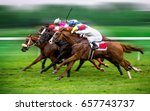 Stock photo race horses with jockeys on the home straight shaving effect 657743737
