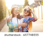 two girls are hugging and... | Shutterstock . vector #657748555