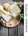 arrangement of gourmet cheese... | Shutterstock . vector #657755761