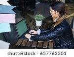 concentrated female blogger in... | Shutterstock . vector #657763201