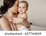 young tender happy mother... | Shutterstock . vector #657764839