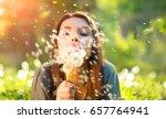 beautiful young woman lying on... | Shutterstock . vector #657764941