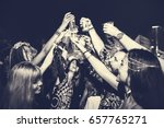 group of friends drinking beers ... | Shutterstock . vector #657765271