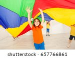 girl hiding under parachute... | Shutterstock . vector #657766861