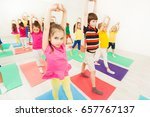 sporty kids stretching during... | Shutterstock . vector #657767137