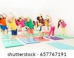 happy kids doing side bending... | Shutterstock . vector #657767191