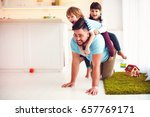 happy mad ride on father's back.... | Shutterstock . vector #657769171