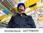 engineer in an industrial... | Shutterstock . vector #657798595