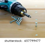 Screw And Electric Drill On A...