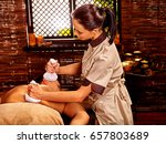 man having ayurveda massage... | Shutterstock . vector #657803689
