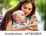 baby feeding spoon by mother in ... | Shutterstock . vector #657803809
