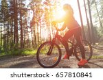 woman riding a mountain bicycle ... | Shutterstock . vector #657810841