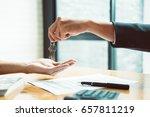 estate agent giving house keys... | Shutterstock . vector #657811219