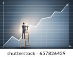 businessman drawing charts... | Shutterstock . vector #657826429