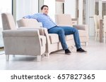 young man shopping in furniture ... | Shutterstock . vector #657827365