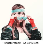 woman in 1980's fashion on a... | Shutterstock . vector #657849325