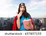 pretty superhero girl eating... | Shutterstock . vector #657857155
