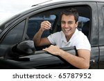 Happy hispanic man showing the key of his new car - stock photo