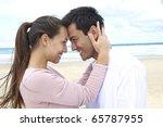 romance on vacation: couple in love on the beach flirting - stock photo