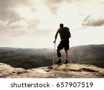 man with a crutches in nature.... | Shutterstock . vector #657907519