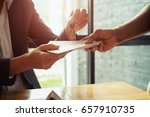 man is handing money to real... | Shutterstock . vector #657910735