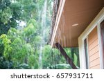 rain flows down from a roof down | Shutterstock . vector #657931711