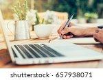 asia man hand writing notebook...   Shutterstock . vector #657938071