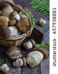 Small photo of Composition of porcini in the basket on wooden background. White edible wild mushrooms. Copy space for your text