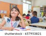 happy elementary schoolgirl... | Shutterstock . vector #657953821
