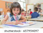 happy schoolgirl writing on... | Shutterstock . vector #657954097