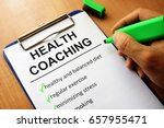 clipboard with health coaching... | Shutterstock . vector #657955471