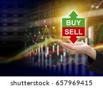 Small photo of Business woman hand holding buy or sell on stock market background