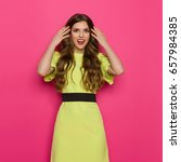 happy young woman in lime green ... | Shutterstock . vector #657984385