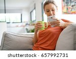 woman relaxing in sofa... | Shutterstock . vector #657992731