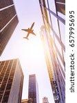 plane flying over modern office ... | Shutterstock . vector #657995695