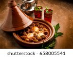 Small photo of cover and tajine with meat balls eggs and green olives