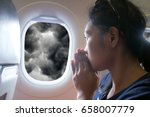 passengers praying in a flying... | Shutterstock . vector #658007779