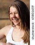 A close up of a joyful woman - stock photo