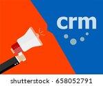 crm. hand holding a megaphone.... | Shutterstock . vector #658052791