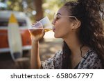 young woman drinking beer... | Shutterstock . vector #658067797