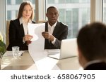Small photo of Multiracial recruiters holding long sheet of paper, looking surprisingly at candidate during job interview, prepared detailed resume with great career achievements, impressive work accomplishments