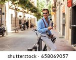 handsome stylish man texting on ... | Shutterstock . vector #658069057