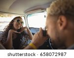 man photographing woman from... | Shutterstock . vector #658072987
