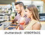 young cheerful couple toasting... | Shutterstock . vector #658095631