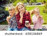 family eating a hamburger... | Shutterstock . vector #658136869