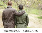 gay couple hugging and walking... | Shutterstock . vector #658167325