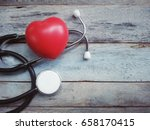 red and stethoscope on old wood ... | Shutterstock . vector #658170415