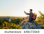 Hiking Man Taking Photo With...