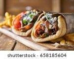 two tasty wrapped greek lamb... | Shutterstock . vector #658185604