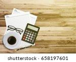 top view work desk with black... | Shutterstock .eps vector #658197601